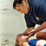 Person performing CPR on Child