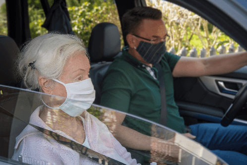 Individuals wearing mask in vehicle